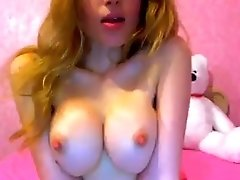 Sweet redhead teen plays with her nice tits in webcam show
